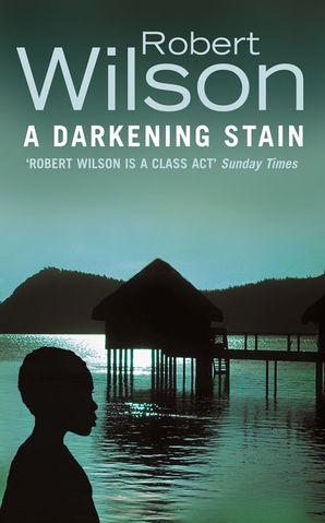 A Darkening Stain Paperback  by Robert Wilson