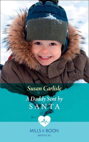 A Daddy Sent By Santa Paperback  by Susan Carlisle